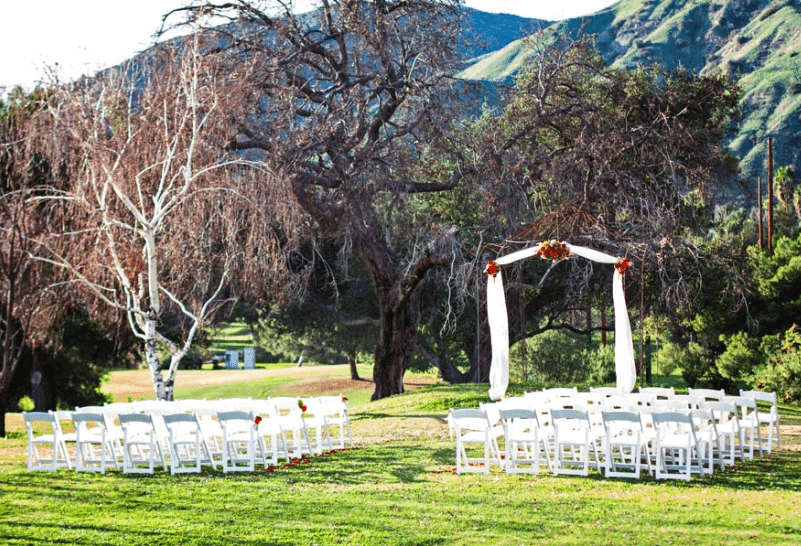 Bare winter branches create a dramatic wedding setting.<br /> Image provided by Wedgewood Sierra La Verne Country Club