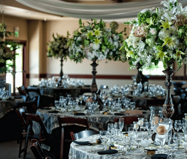 Silver, white and green set a delightful winter table. Image provided by Hulse Photography