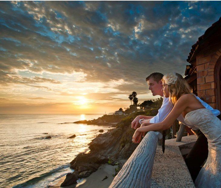 Bride and Groom gaze at ocean