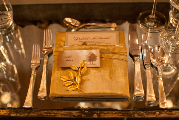 This Gold Napkin Embellished With A Golden Leaf, Holds A Menu And A Seating Card. Image Provided By White Lilac Event Design