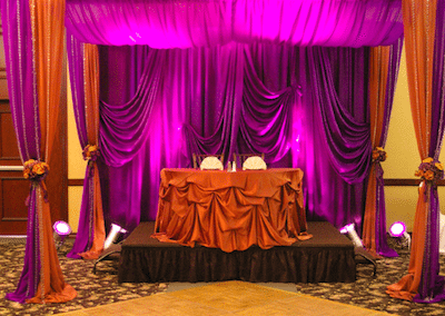 Colorful drapery creates an intimate space. Image provided by The Finishing Touch Wedding Design