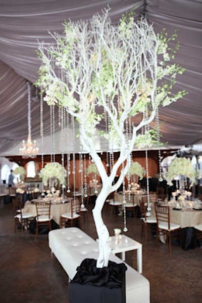 A cloud of white branches, filled with white flowers and crystals make a gorgeous centerpiece<br>Image provided by A Good Affair Event Design