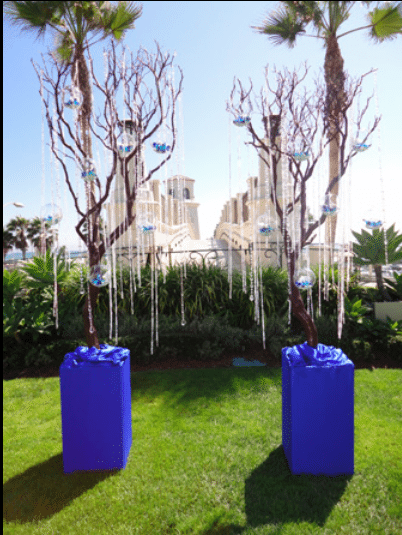 Tree branches dripping with crystals and glass balls filled with blowers make a lovely setting<br>Image provided by The Finishing Touch Event Design