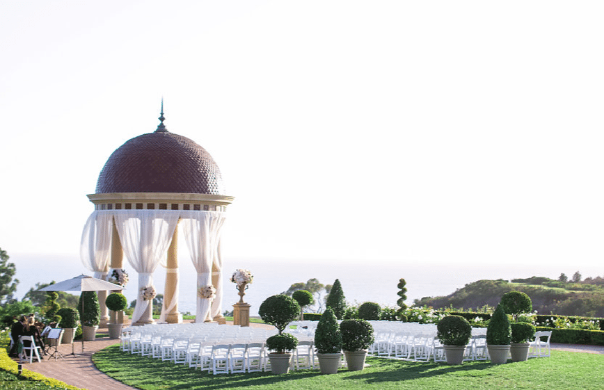 Topiary trees define the space for an elegant wedding Image provided by A Good Affair Event Design