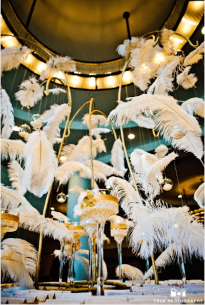 Creative use of feathers in place of flowers for a modern event Image provided by Organic Elements Event Design, Photography by True Photography