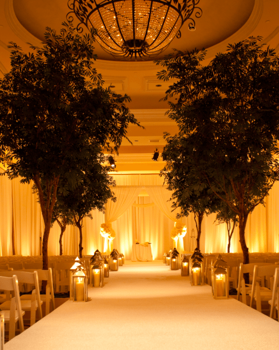 Towering trees bring the outside indoors Image provided by White Lilac Event Design
