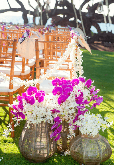 Hand woven baskets filled with pink and white orchids, fans and sun glasses put guests in a tropical state of mind. Design by A Good Affair Wedding and Event Production<br /> Photography by KLK Photography