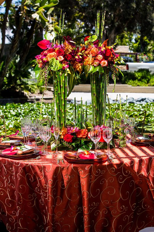 Pair tall rushes with lush tropical blooms for a stately feel.<br /> Design by Lois Mathews Design<br /> Photography by Kristina Chartier Photography