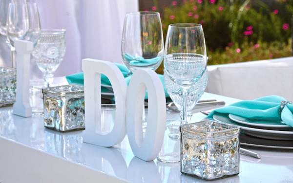 Personalize a head table with just the right sentiment. Image provided by Signature Party Rentals