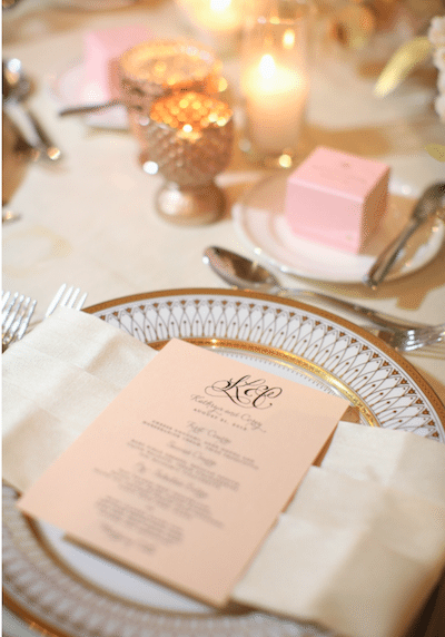 Use an elegant monogram throughout your event, from invitations, to gobos shining on the dance floor and even on menus.<br /> Planning and design: A Good Affair Wedding and Event Productions<br /> Photography by Jasmine Star