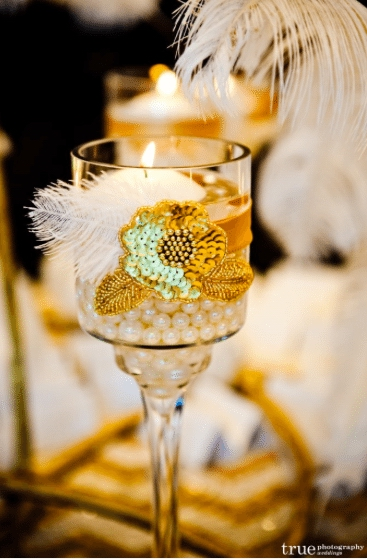 Ribbon, pearls and sequins decorate this candle holder Image provided by Organic Elements Event Design