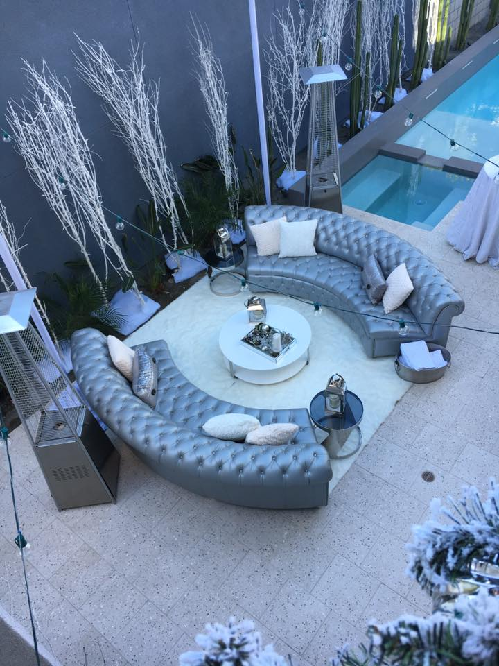 Create a lounge that compliments the season such as this winter design using modern lanterns, with fur rug & pillows that gives that comfy & cozy feel. Consider also providing blankets or pashmina scarves as a little warm up on cold evening. - Kevin Covey - Christine Bentley - Reception Lounge