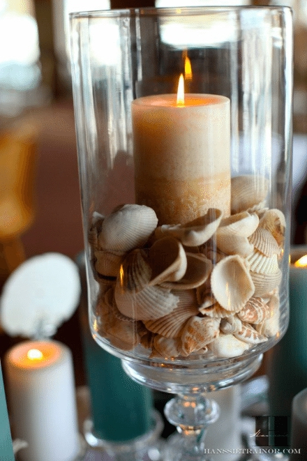 Sea shells set the tone for an elegant beach rehearsal dinner. Image provided by French Buckets Florist – Photography by Hanssie Trainor Photography - WeddingCompass.com
