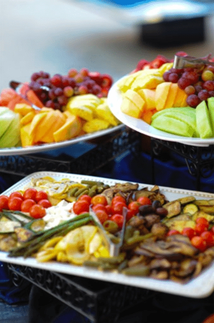 A selection of marinaded vegetables and fresh fruit are perfect accompaniments for a BBQ. Image provided by Gourmet Gourmet Catering - WeddingCompass.com
