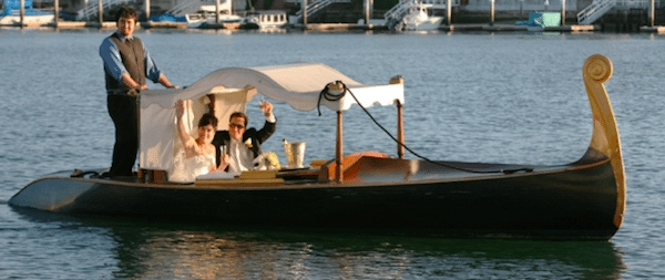 A romantic departure complete with champagne and a singing gondolier. Image provided by Lawrence Crandall Photography - WeddingCompass.com