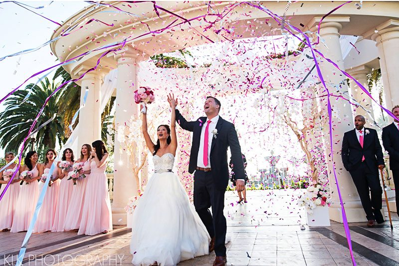 Bright streamers and confetti fill the air Image provided by A Good Affair, Wedding and Event Production Photography by KLK Photography
