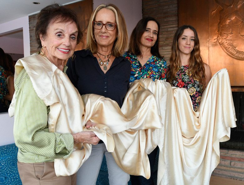 Anita Prietto, Marta Prietto O'Hara, Elena Salinas and Pilar O'Hara Kassouf with the dress that ties them all together. Four generations of the same family have worn the same wedding dress since 1932. Los Angeles, CA 10/11/2017 (Photo by John McCoy, Los Angeles Daily News/SCNG)