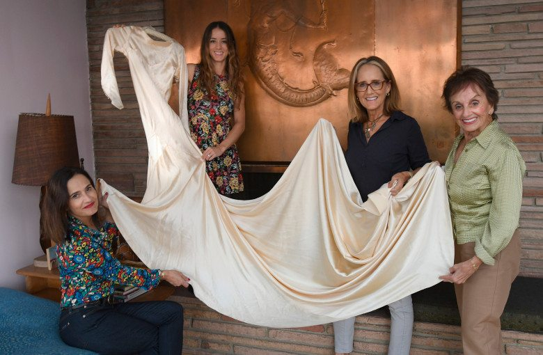 Elena Salinas, Pilar O'Hara Kassoug, Marta Prietto O'Hara and Anita Prietto with the dress that ties them all together. Four generations of the same family have worn the same wedding dress since 1932. Los Angeles, CA 10/11/2017 (Photo by John McCoy, Los Angeles Daily News/SCNG)