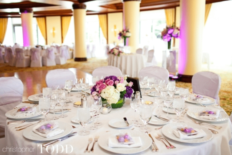 Uplighting and touches of color on the place settings tie the design elements together. Image provided by Christopher Todd Photography