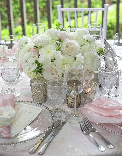 Soft, frilly petals and candlelight combine with sparkling crystal and touches of pink for an elegant style. Image provided by Kevin Covey Weddings and Events