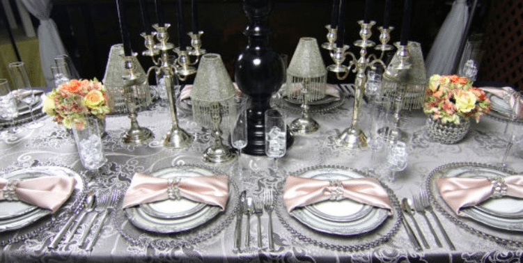 Soft pink, silver and crystal combine with hints of black to create an elegant setting. Image provided by Baker Party Rentals