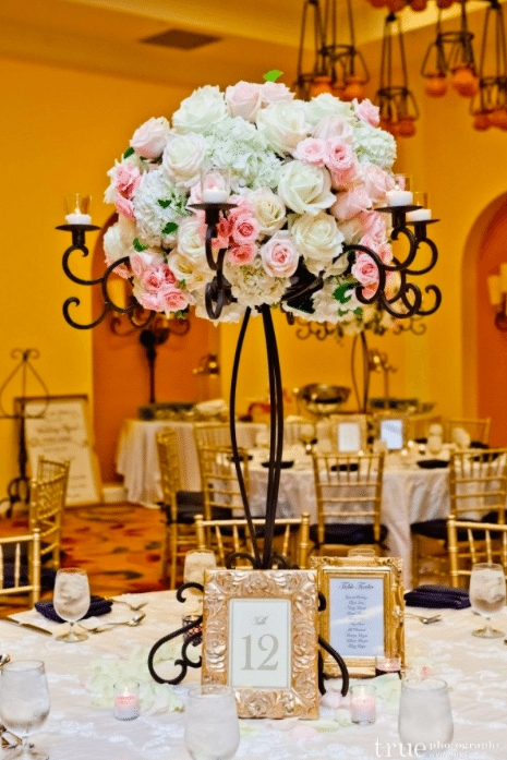 Wrought iron makes a beautiful basis for a dramatic centerpiece. Image provided by: Organic Elements