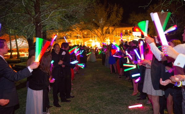 Glow sticks light the way Image provided by Robert Evans Photography - WeddingCompass.com