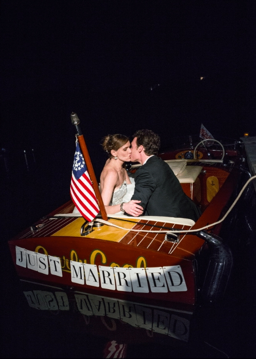 Be the captain of the boat and sail off to your honeymoon - Image provided by Robert Evans Studios - WeddingCompass.com