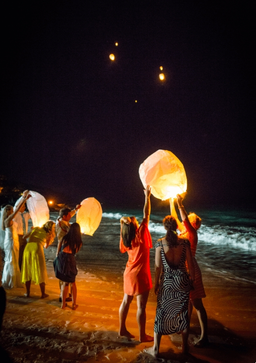 Let guests fill the sky with glowing orbs Image provided by Robert Evans Studios - WeddingCompass.com